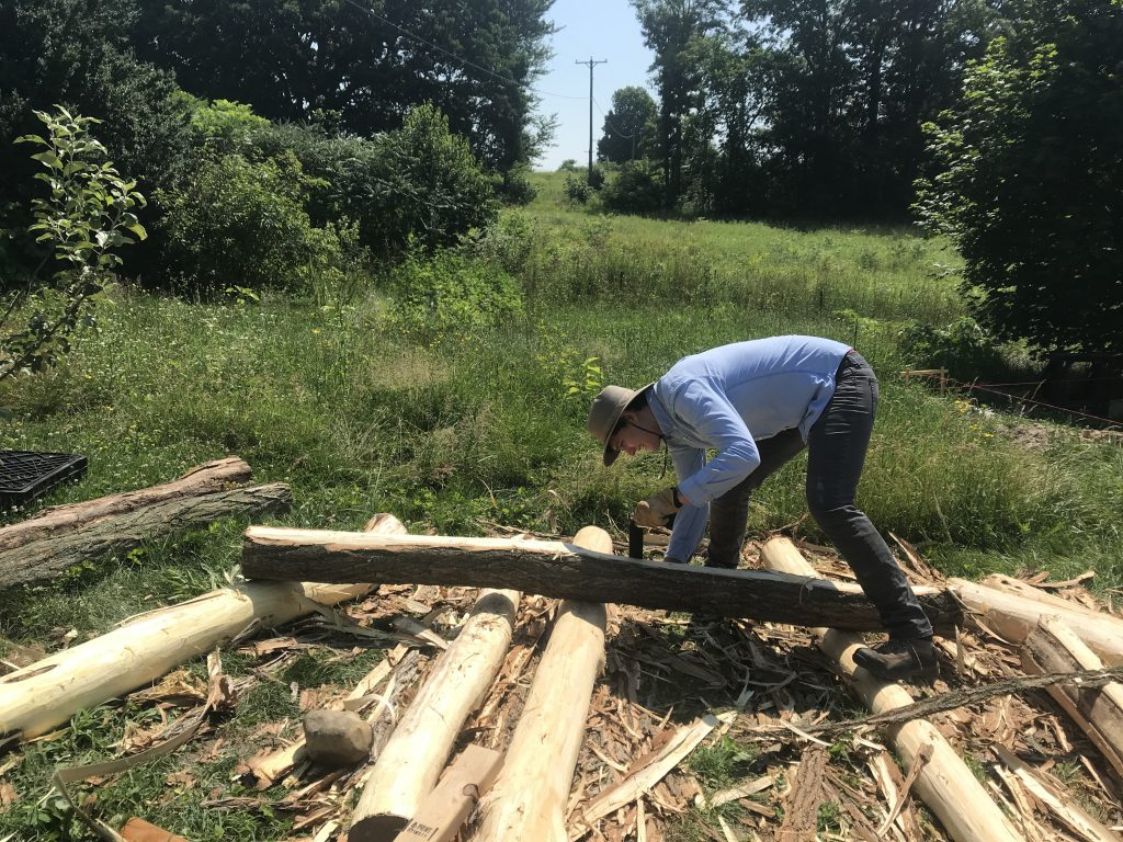 student preparing logs for build
